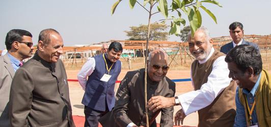President Ramnath Govind is planting a tree at Kanha Shantivanam