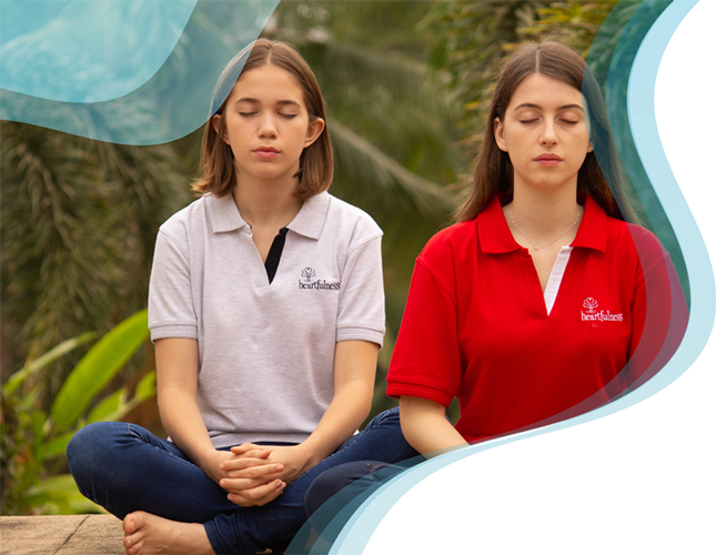 Two young women closed their eyes and meditating