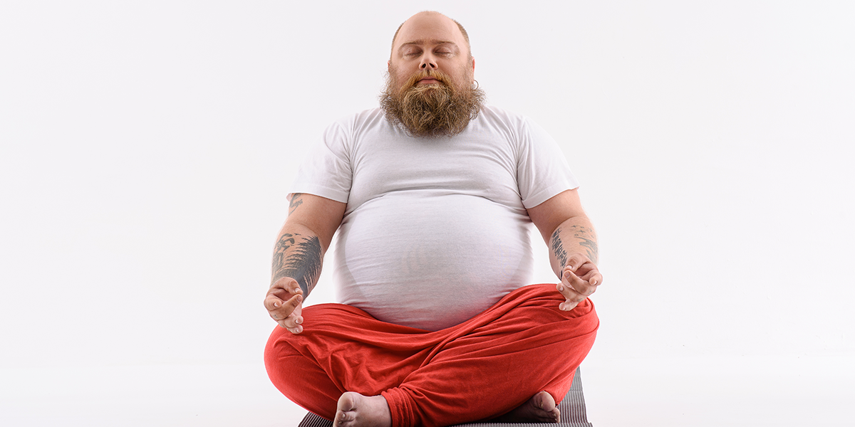 fat man is meditating to lose weight