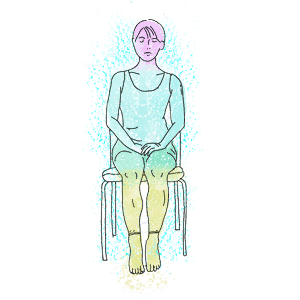 woman sitting on the chair is practicing heartfulness relaxation